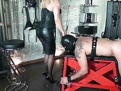 Femdom punishing slave on spanking bench by crop and cane