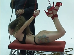 Toned bdsm brunette is restrained from ceiling by her arms, ankles and hair