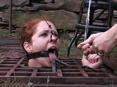 Lovely beauty gets facial torture during bdsm play
