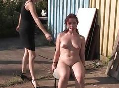 Pliant slave surrenders her lovely twat in public