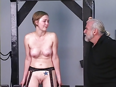 Young blonde receives beldam training from experienced master Len