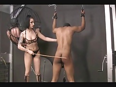 Shambok with the addition of caning the prisoner by shake out Cybill Troy