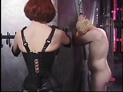 Ginger mistress needling her blonde male slave