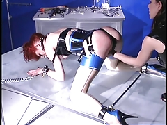 Horny redhaired  hottie strapped to table and seduced
