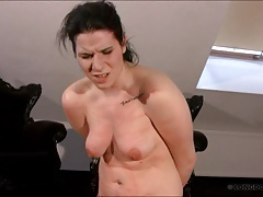Lussy in bondage for hard breast whipping.