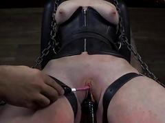 Onerous gal in shackles receives her cunt pumped