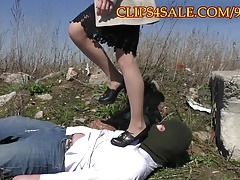 Trampling under sexy heels outdoor