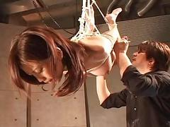 Asian old bag hangs on transmitted to ropes as A shes spun