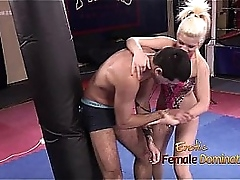 Blond Mistress kicking and perforating loser slave