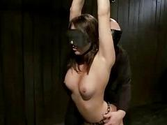Shackled babe manhandled and fingered