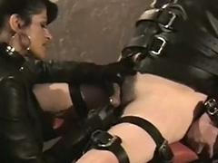 Mistress with beamy tits burns balls of tied slave