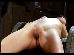 Girl with interior bondage getting tied to wood spin whipped