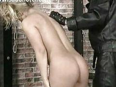 Blonde bdsm slave girl punished by masked master
