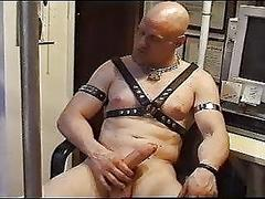 Bald man stroking his stiff dick