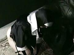 Horny nun slave with fat ass is lying on the floor and is sp