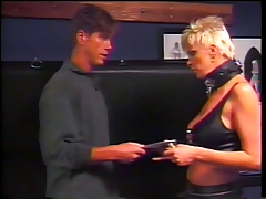 Blond dominatrix puts pinches at bottom guy's cock