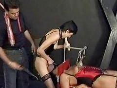 Slave with metal clamps on say no to nipples and say no to face and crowd