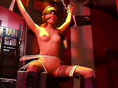 Whore with a nice rack, bound, with her legs spread for her adroit
