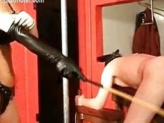 Camouflaged bending over dirty slave is spanked apropos a wooden sti