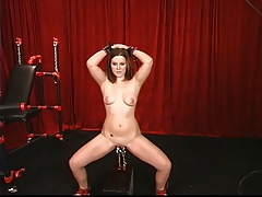 Down in the mouth young brunette has her pussy clamped and weighted down at the end of one's tether master