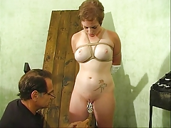 Cute old bag with a nice rack bound by her master for some fun