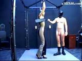 Girl With Tied Arms And Pvc Overall Whipped Fingered Spanked Hard by The Master In The Dungeon