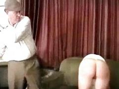 Girl in sickly lingerie whipped spanked with stick by master