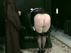 Horny nun slave is spanked on her fat ass and hooves by older