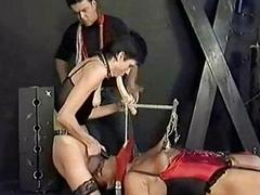 Ebony slave tied to a workbench covered in candlewax got lar