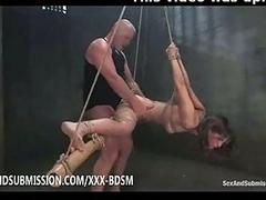 Bondage brunette babe gives blowjob with an increment of fucking