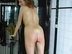 Horny slave with clit crucial is spanked on the brush butt by ang