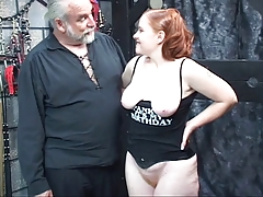 Redhead slut Kirsten sucks her master's cock then gets fucked and spanked