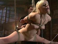 Busty captive used as sex usherette