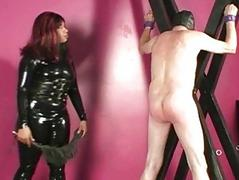 Black domina spanks and whips suspended pave slave