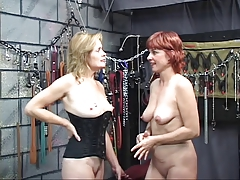 Two sexy, kinky mature babes shot at some hot, bi fun in the dungeon