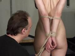 Rope bondage and sexy restrained kinky brunette