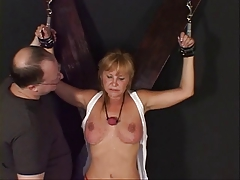 Gal with a nice rack at the eliminate of a BDSM session