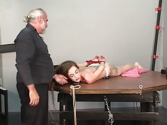Young female sub gets will not hear of legs and hands stretched by mature old hand