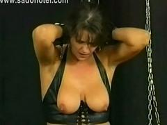Gorgeous milf slave is spanked and got large metal clamps w