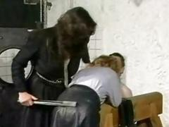 Slave in leather skirt is slant over by horny dominatrix with