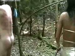 Horny mistress hit tied slave on his back with a whip and fu