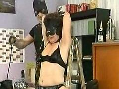 Masked slave gets pulled not susceptible her nipples and metal clamps not susceptible