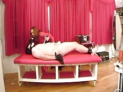 BDSM dominatrix makes him wear a gas mask, restrains his balls, coupled with fingers him
